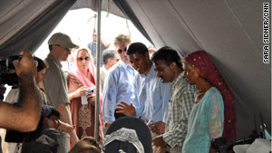Rajiv Shah, third from right, visited two relief camps in Pakistan to get an idea of flood victims' needs.