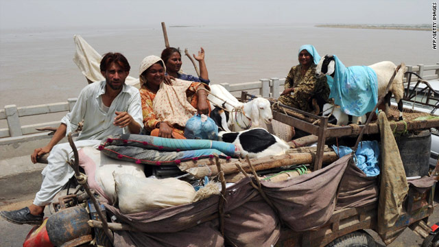 Villagers evacuate Thursday in Pakistan's Sindh province, as water levels rise, and more rain is likely for the flood-ravaged nation.