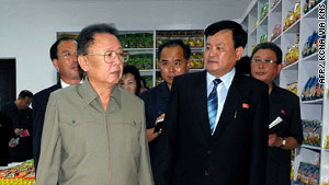 Undated photo of Kim Jong-Il (left) at a Pyongyang factory. Source: N. Korea's official Korean Central News Agency August 26.