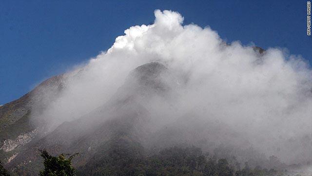 Mount Sinabung spews thick smoke after erupting in North Sumatra.