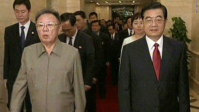A still from state-run TV shows N. Korean leader Kim Jong-Il (L) with Chinese President Hu Jintao on August 27, 2010.