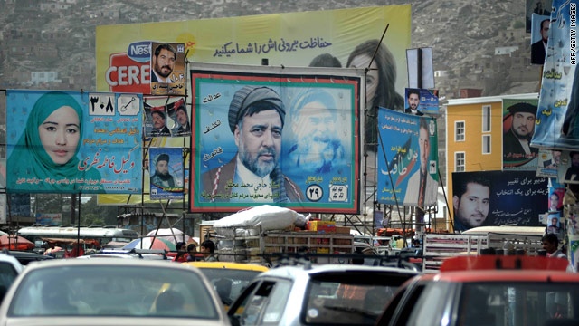 Electoral banners featuring images of Afghan politicians appear on hoardings in Kabul on August 28, 2010.
