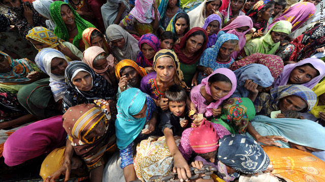 Internally displaced Pakistani women wait for relief goods in Larkana on September 3. Relief efforts in flood-ravaged Pakistan are being stretched by the 'unprecedented scale' of the disaster.