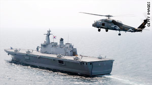 U.S. officials said the naval exercises are in response to North Korea's alleged sinking of a South Korean warship.