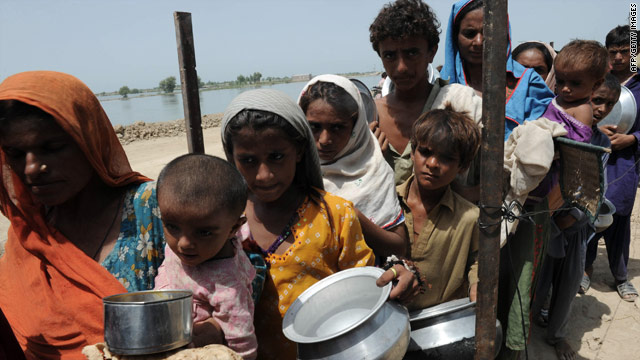 Pakistanis queue for army-provided food near a makeshift camp in the Kali Mori area of Khairpur Nathan Shah on Tuesday.
