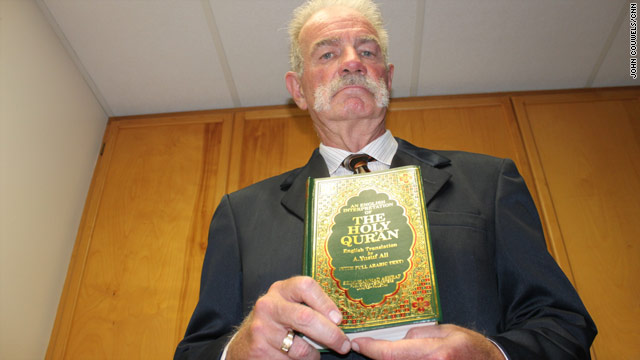 Terry Jones holds one of the Qurans he plans to burn on September 11, 2010 at his church.
