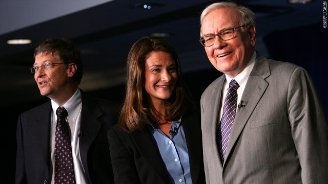 Bill Gates, left, his wife Melinda, and Warren Buffett in this file photo from 2006 shortly after both men both pledged to donate their wealth to charity.