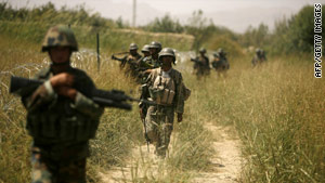 Afghan troops patrol the outskirts of the town of Jellawar in the Arghandab valley.