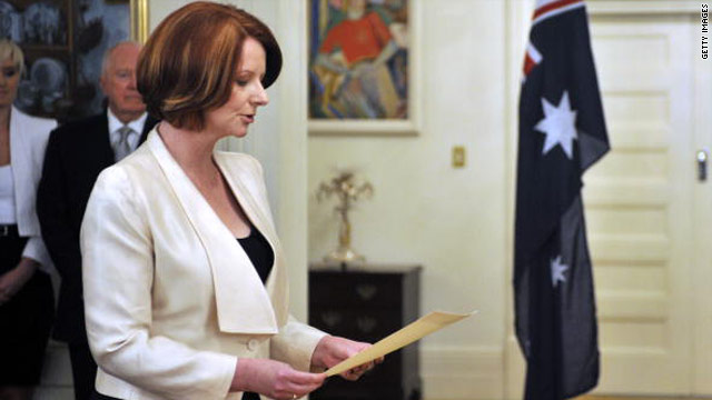 Prime Minister Julia Gillard takes part in the swearing-in ceremony at Government House in Canberra.