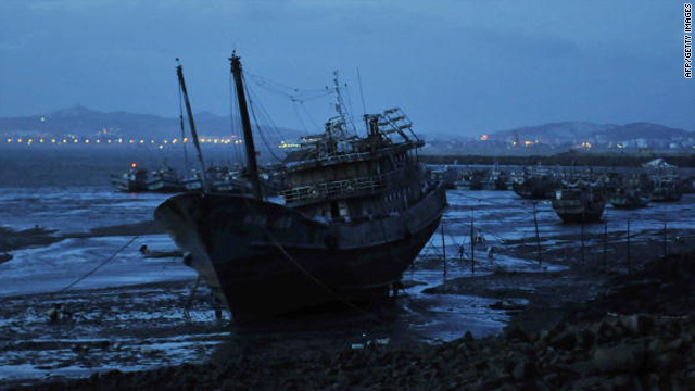 Chinese fishing boats are berthed along the coast in Jinjiang, in southeast China's Fujian province on September 9, 2010, where the Chinese crew set sail before being arrested by Japanese authorities.