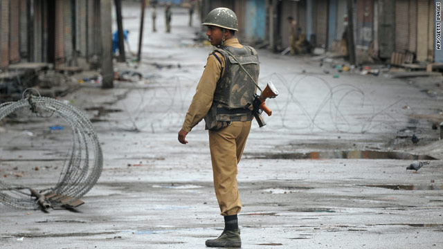 An Indian paramilitary soldier patrols the curfew bound streets of Srinigar on September 14, 2010.
