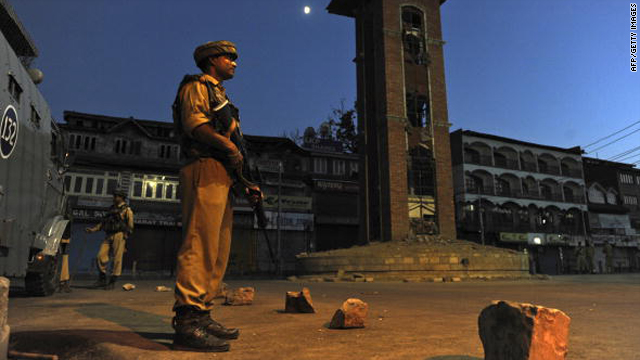 An Indian paramilitary soldiers stands guard in a curfew bound street in Srinagar on Thursday.