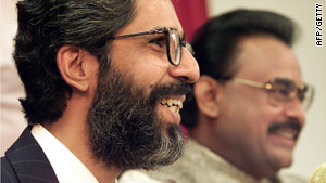 Imran Farooq (left), pictured here in London, 1999, suffered stab wounds and head injuries according to police.