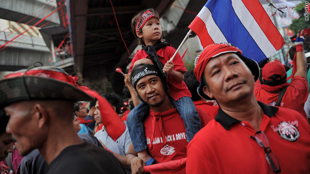 Anti-goverment protesters march in Bangkok on Sunday to mark the anniversary of 2006 coup.