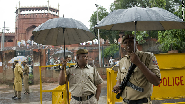 Indian policemen stand guard Sunday near New Delhi's Jama Masjid mosque where two foreign tourists were shot.