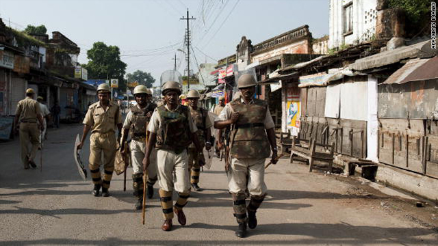 Indian security personnel patrol the streets of Ayodhya on Thursday ahead of the verdict on the holy site.