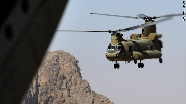 A U.S. Army Chinook helicopter ferries NATO-led U.S. soldiers in southern Afghanistan, close to the Pakistani border.