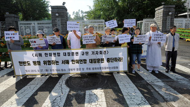 Anti-war activists hold a rally against a joint anti-submarine exercise, outside the Defence Ministry in Seoul on Monday.