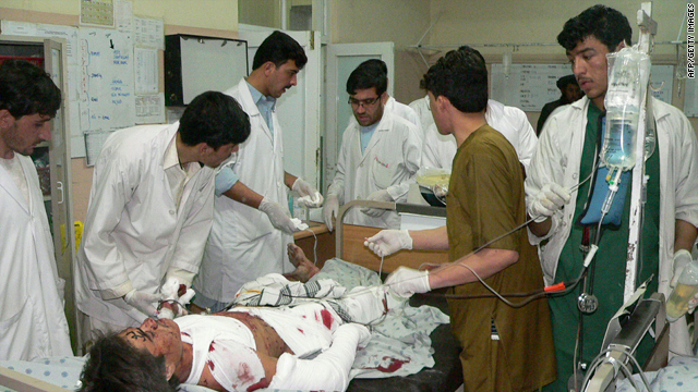 Afghan doctors treat a man wounded in a bomb explosion in Kandahar late Tuesday.