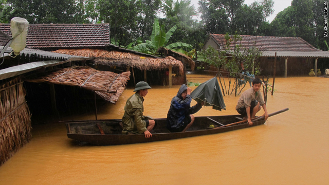 Villagers leave their flooded homes on a small boat in the central province of Ha Tinh, Vietnam, on Wednesday.