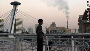 Smoke rises from a chimney in Tianjin where the U.N. Climate Change Conference was held.