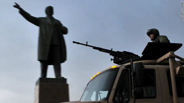 Kyrgyz soldiers patrol near a monument dedicated to Soviet leader Vladimir Lenin in Osh on Sunday.
