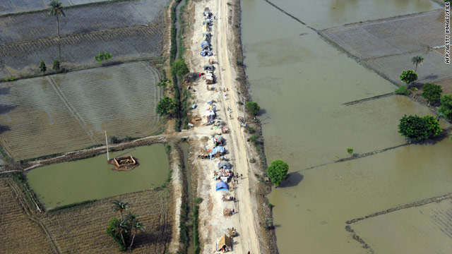 In an aerial view, Pakistanis displaced by flooding head to higher ground in Punjab province in August.