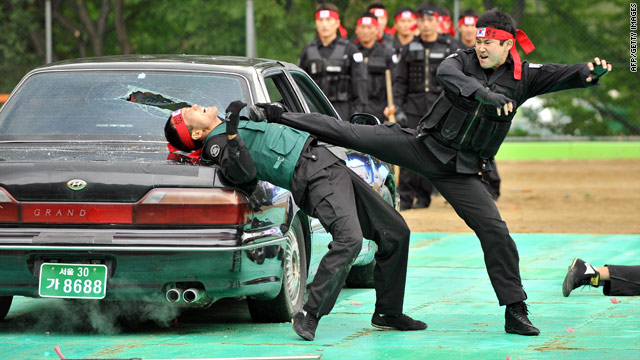 A member of South Korea's G20 Police Security Unit displays his martial arts skills.
