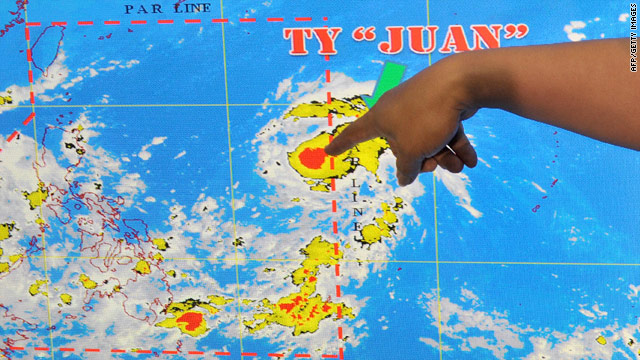 A meteorologist points to a satellite image of Typhoon Megi, known locally as Juan, in Manila on October 16.