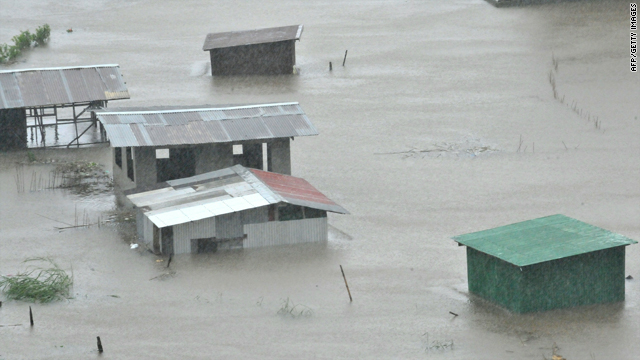 Houses in Baguio City, Philippines, lie submerged by flooding Tuesday due to heavy rains brought by Typhoon Megi.