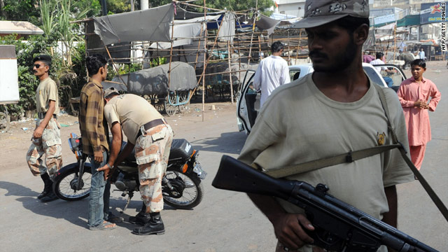Pakistani security forces stand guard on a street in Karachi on October 20.