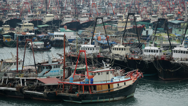 Fishing boats sit moored in a typhoon shelter in Hong Kong on October 21, 2010.