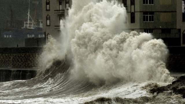 Waves crash into a waterfront wall in Zhangpu on October 23, 2010 in Fujian province, China.