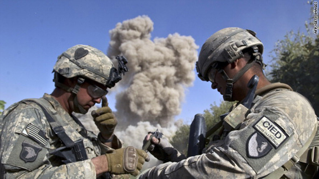U.S. soldiers explode an unused building, as they believe the Taliban will use it, in Kandahar province on 25 October, 2010.