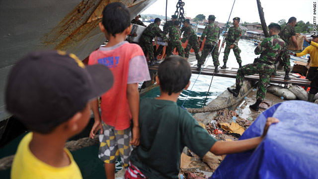 Soldiers unload aid for tsunami and victims in Indonesia's Mentawai islands.