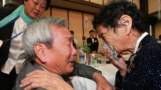 North Korean Kim Ho-Sook, right, 83, meets her South Korean brother Kim Ho-Dae during a family reunion after being separated for 60 years on Saturday in Mount Kumgang, North Korea.