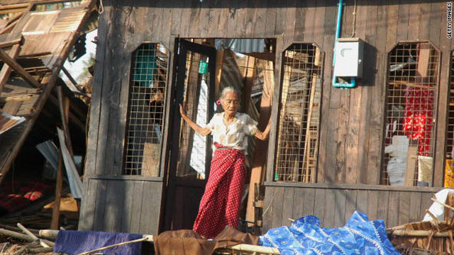 An elderly woman comes out of her destroyed house in the worst cyclone-hit Dedaye township, some 48 kilometers south of Yangon, on May 9, 2008.
