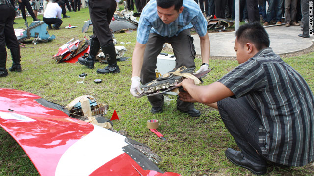 Indonesian police gather pieces of debris of a Qantas Airbus A380 engine casing that fell from the aircraft while in flight, at the police headquarters in Batam city on November 4.