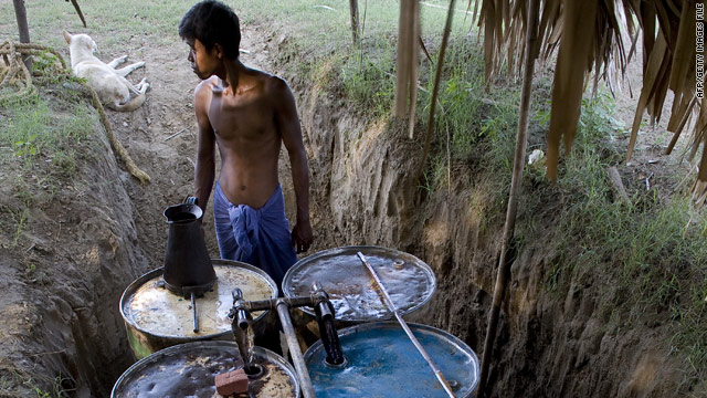 Photo taken in 2009 shows a farmer using a homemade system to filter oil residue into a kind of diesel fuel. The underground economy of Myanmar is equal to its official GDP, analysts say.