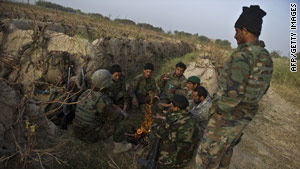 Afghan troops keep warm on a joint patrol with U.S. troops in Kandahar province last month.