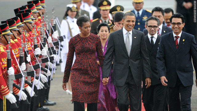 U.S. President Barack Obama (C, front) with First Lady Michelle Obama are met by Indonesian officials upon arrival in Jakarta.