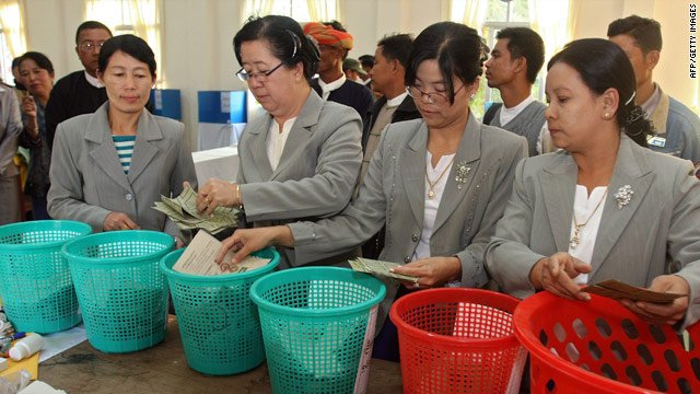 Myanmar officials taking part in the counting process at a polling station in Taunggyi, eastern Shan state.