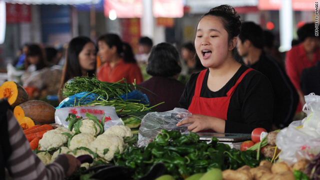 A vendor sells vegetables at a food market in Hefei, east China's Anhui province on October 21, 2010.