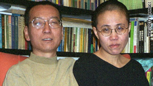 Liu Xiaobo (L) and his wife Liu Xia pose for a photograph in Beijing, 22 October 2002.