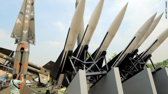 A visitor takes pictures of replicas of North Korea's Scud-B missile, center green, and South Korean missiles that are displayed at the Korean War Memorial in Seoul on June 28, 2010.
