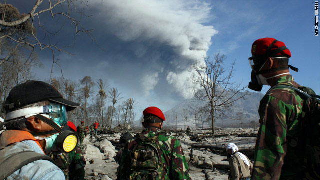 Indonesian Special Forces look for victims of the Merapi eruption in the village of Glagaharjo on November 12, 2010.