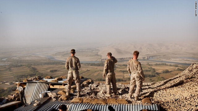 U.S. Marines look out over the Helmand River from outpost West perched above Forward Operating Base (FOB) Zeebrugge on October 23, 2010 in Kajaki.
