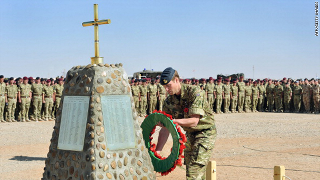 Britain's Prince William places a wreath on the memorial to the British Soliders killed in Afghanistan on November 14, 2010 during a remembrance day ceremony at Camp Bastion in southern Afghanistan.