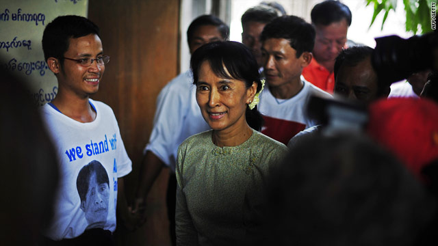 Aung San Suu Kyi arrives at the National League for Democracy HQ in Yangon on Monday -- she is calling for dialogue.