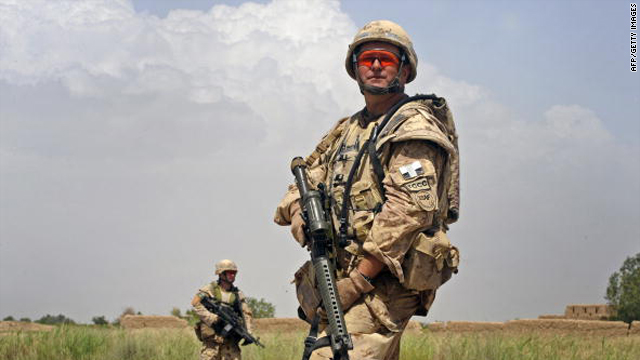 Canadian soldiers patrol in Belanday village, Dand district in Kandahar on May 17, 2010.